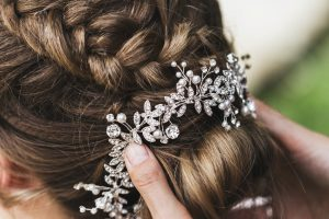 Hairpin in the bride's hair, wedding hairstyle with accessories with jewelery
