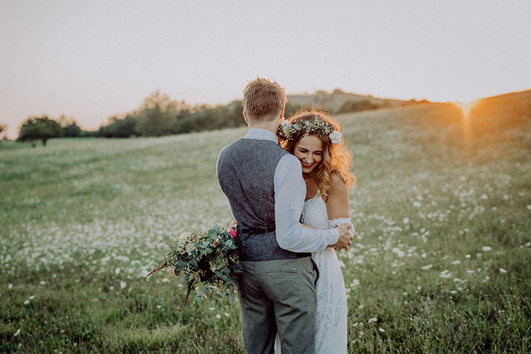 beautiful-bride-and-groom-at-sunset-in-green-PSXZA49.jpg