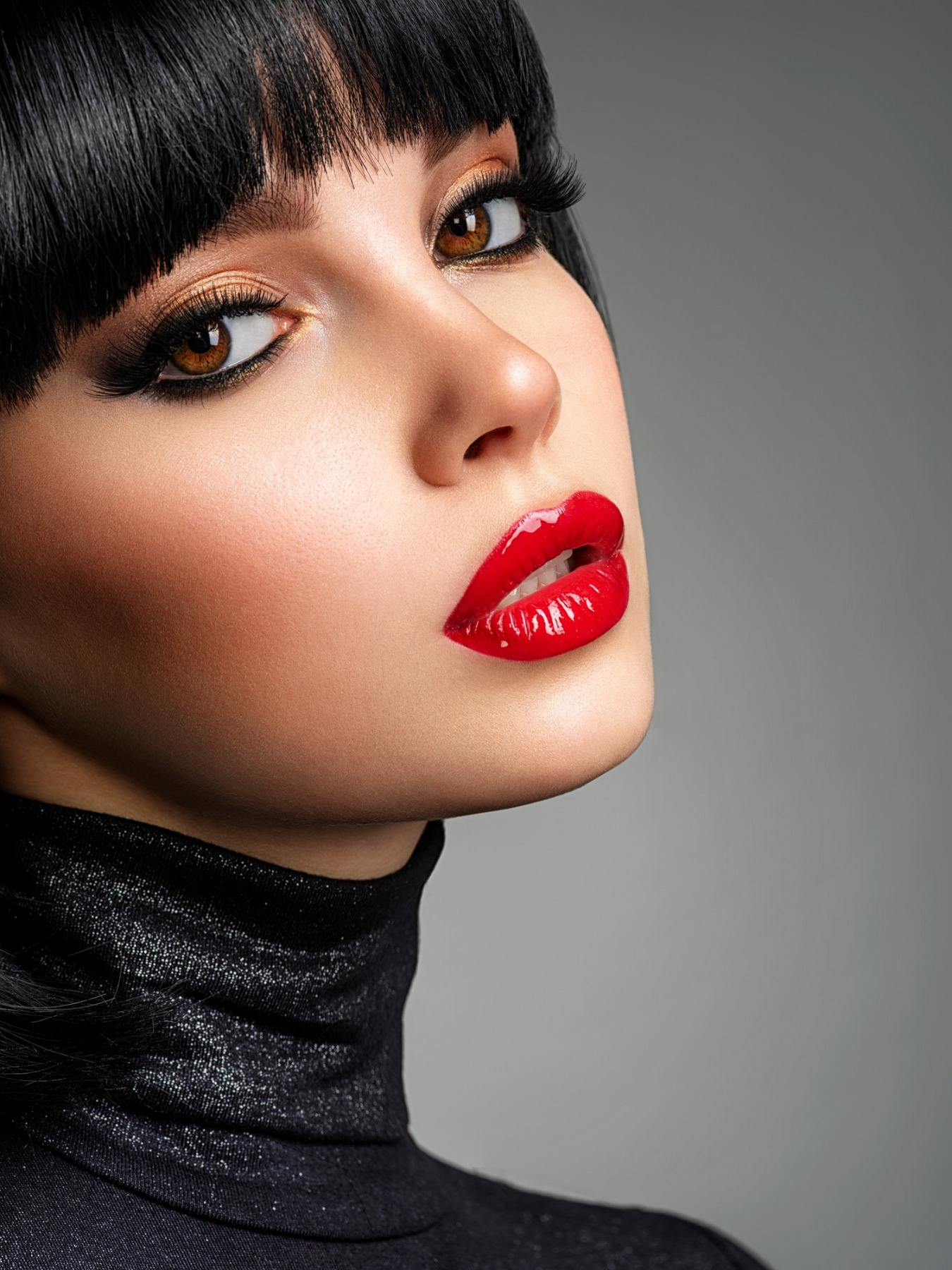 Beautiful brunette girl with red lips and black bob hairstyle.