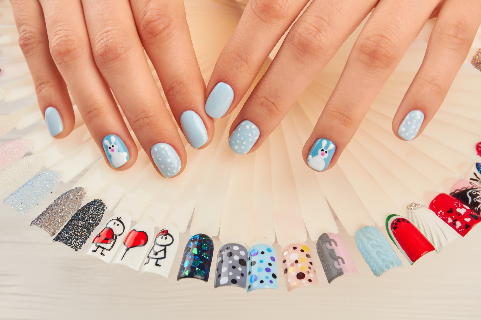 Manicured hands and nail art samples
